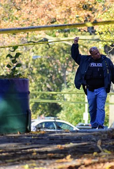 A St. Louis police officer walks onto the scene where a retired sergeant was killed this morning.