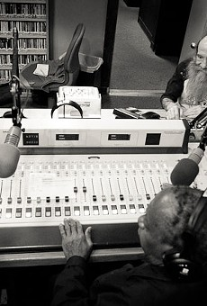 Gabriel (bottom) sits at the control desk in KDHX's main studio with Dennis Brannaker (right) and Hound Dog Brown (left)