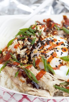"""Guerilla Street Food's """"Flying Pig,"""" with slow-roasted pulled pork and a one-hour egg served over rice."""