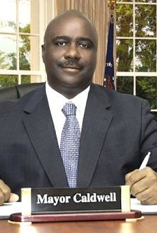 Sylvester Caldwell used this obviously Photoshopped portrait of himself sitting in the Oval Office as his official picture on the Pine Lawn city website.