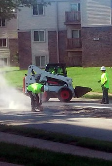 A crew paid for by the Lipton Group takes out the chunk of pavement.