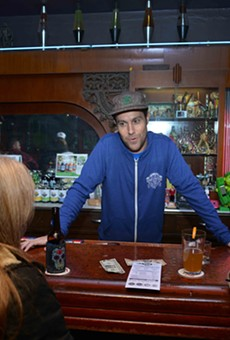 Joshua Grigaitis, aka Joshua Loyal, works the Pop's Blue Moon bar.