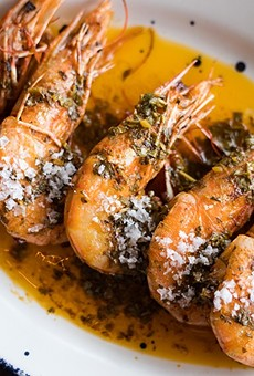"""Prawns a la Plancha"" are served head-on and dressed with garlic, smoked paprika and lemon."
