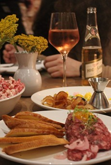 Beef tartare and beet powder-flavored popcorn are among the appetizers at Pop.