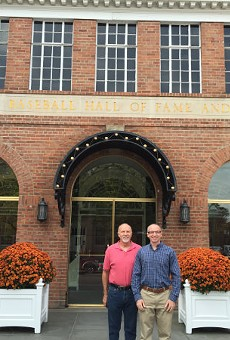 Bill Clevlen (right) with his dad, Rick, in front of the National Baseball Hall of Fame in Cooperstown, New York.