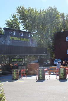 Jack Daniel's barrels and picnic tables outside Byrd and Barrel.