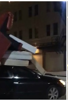 St. Louis Legend Rolls Stop Sign With 6 Mattresses and 2 Couches on Car Roof