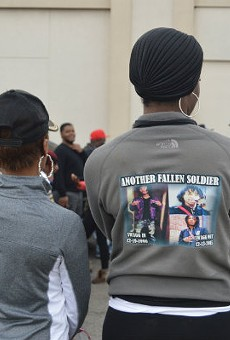 A mourner outside the funeral for James Johnson Jr.