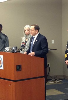 Mayor Slay, at lectern, says a new Crime Commission will help fight violence in St. Louis.