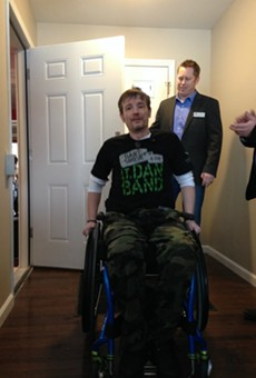 Chris Sanna enters his House Springs home for the first time since he was shot in September 2015 in downtown St. Louis.