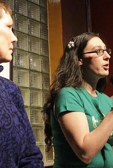 Alderwoman Megan Ellyia Green, center, at a political debate.