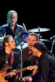 Springsteen and his E Street buddies — Lofgren is on the left.