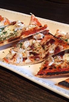 The American flatbread pizza comes with spicy blue cheese sauce, chicken and crispy bacon.