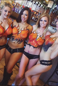 Servers at Social House's original location, in Soulard, show off the body paint that the bar is known for.