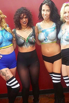 Servers at the Social House II show off the body paint the concept is known for.