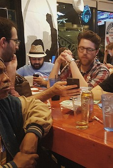 Supporters at Bernie Sanders' watch party in downtown St. Louis monitor election returns.
