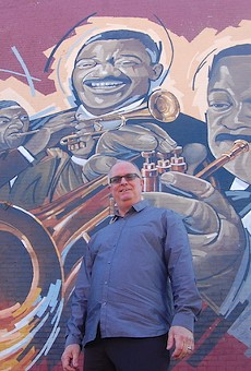 Artist Ray Harvey in front of his mural.