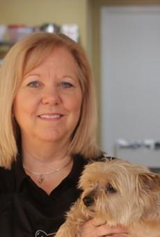 Kathy Caton on her companion at Three Dog Bakery.