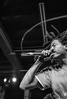 Ciej of hip-hop collective M.M.E. hits the mic at last year's RFT Music Showcase in the Grove.