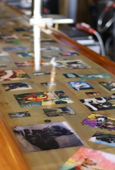 The bar is covered in photos of dogs sent in by customers. Since it is covered in resin, they are no longer accepting photos.