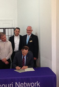 Mayor Francis Slay signs a good Samaritan bill that protects drug users who call 911 to report overdoses.