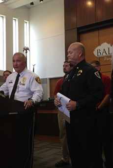 St. Louis County police Chief Jon Belmar (l) and Ballwin police Chief Kevin Scott say an officer was ambushed during a traffic stop on Friday.