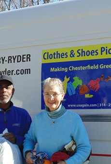 Chesterfield resident Darcy Capstick gives used clothing to a USAgain driver during one of the city's first-ever textile pickups.