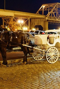 Horse-drawn carriages are a popular tourist attraction downtown.