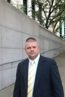Ex-Pine Lawn police lieutenant Steven Blakeney leaves federal court on Wednesday.