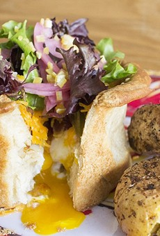 """The """"Nest Egg"""" features a buttery biscuit crust filled with cheddar, bacon, two Buttonwood Farm eggs, pickled red onion and preserved lemon."""