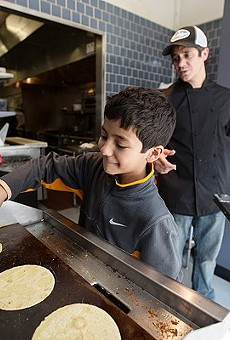 Mission Taco Chef-Owner Jason Tilford with his son, then 10, in the kitchen. The taco joint is great for date night — but also surprisingly accommodating to young families.