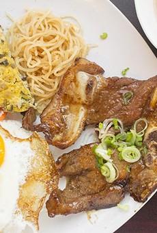 Com Tam Dac Biet includes a grilled honey-glazed lemongrass pork chop, a fried egg, a Vietnamese egg cake and shredded pork skin with broken rice.