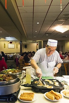 The chef at Mandarin House works a griddle in the middle of the dining room.