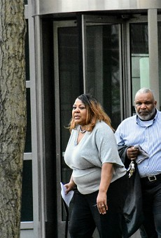 Former St. Louis Police Office Terri Owens (left) leaves federal  court on Tuesday with her family.