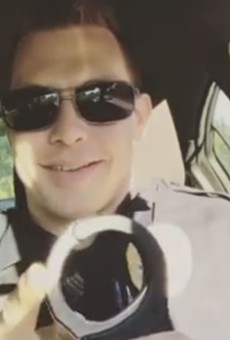 Ex-officer Mike Weston plays with his handcuffs in one of his Instagram posts.