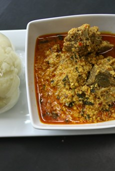 Eugsi Soup- Goat meat soup served with pounded yam.