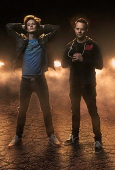 Guitarist Ryan Phillips, on the right in the photo, recently competed for an upcoming episode of American Ninja Warrior.