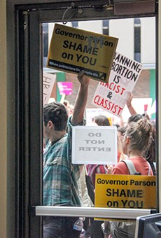Protesters opposing new abortion restrictions gather outside the Wainwright Building last week.