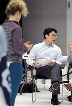 From left, doctors Albert Kim and Eric Leuthardt discussing BrainWorks.