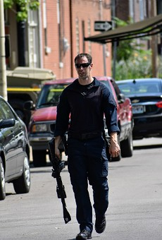 An officer leaves the scene of a five-hour standoff in Tower Grove South.