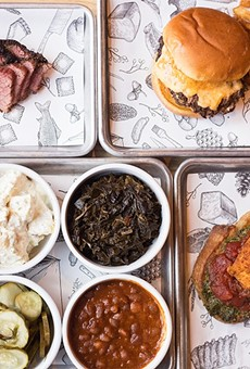 The goods from The Midwestern Meat & Drink: pastrami, double cheeseburger, fried burrata toast and a selection of sides.