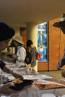 Rana Mohammedali serves Iraqi food as a part of the International Institute's International Lunch Series.