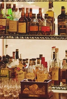 Whiskey, scotch, bourbon, rye and more line the shelves at (IN)Famous Bar inside The Wine & Cheese Place in Clayton.