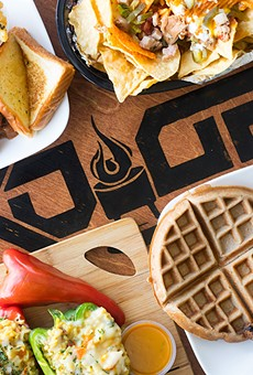 """A selection of items from TKO Grill (pictured from top left to right): """"On The Ropes"""" turkey ribs combo, """"Uppercut"""" nachos, stuffed peppers and """"Pluck 'N' Waffles,"""" a chicken and waffles combo."""