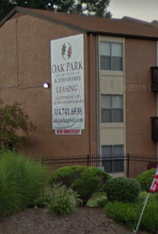 A thirteen-year-old was walking by Oak Park Apartments when he was shot, police say.