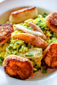 Sea scallops with risotto, crab meat, spinach, artichokes and brown butter sauce