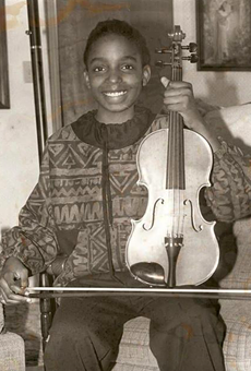 Conaway with her violin after winning a bronze medal at a state music competition at the age of 10.