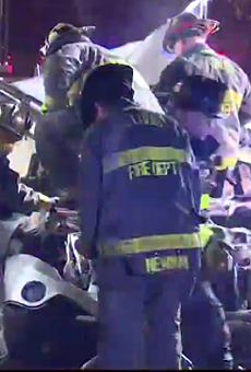 Firefighters at the scene of Tuesday's deadly crash.