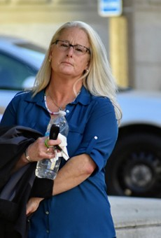 Ex-St. Louis police officer Lori Wozniak leaves court on November 5.