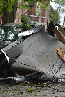 Debris from a roof landed against a car on Indiana Avenue during last night's storm.